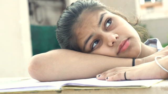young girl studying and thinking - person in education stock videos & royalty-free footage