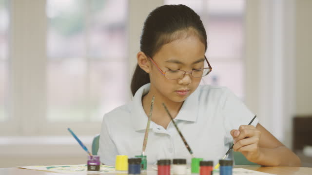 young girl studying art while home schooling - fatcamera stock videos and b-roll footage