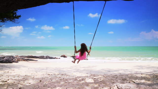 ws rv young girl swinging on a swing at the beach - nur mädchen stock-videos und b-roll-filmmaterial