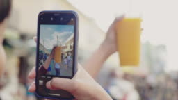 Young girl take a photo of trendy drink
