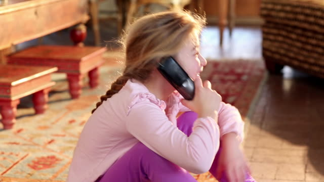 MS Young girl talking on phone / Lamy, New Mexico, United States