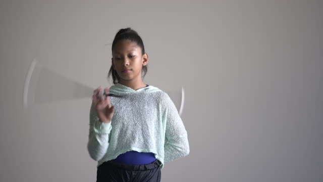 ms young girl twirling a baton in a dance studio - pre adolescent child stock videos & royalty-free footage