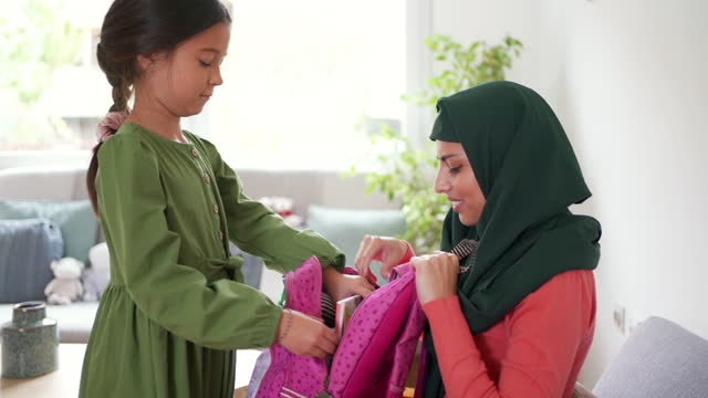 young girl unpacking her backpack while her mother is helping her - school supplies stock videos & royalty-free footage