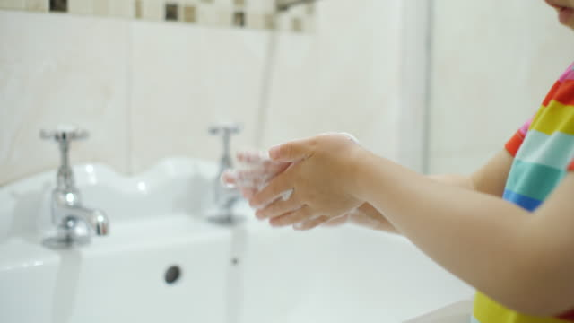 young girl using soap and water washing hand in bathroom - domestic bathroom stock videos & royalty-free footage