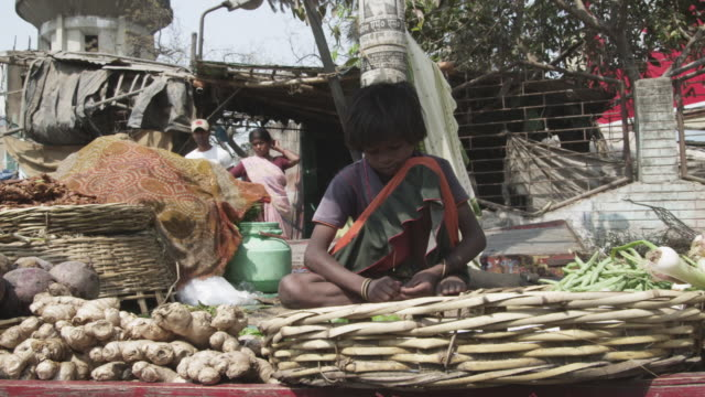WS Young girl vegetable vendor at street market / Patna, Bihar, India
