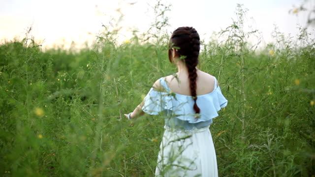 young girl walking at grassland
