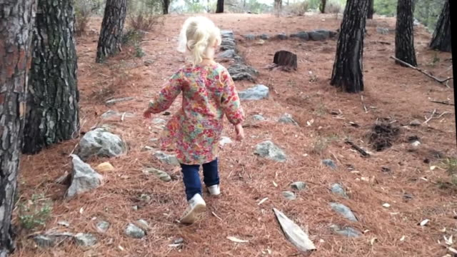 Young girl walking away from camera