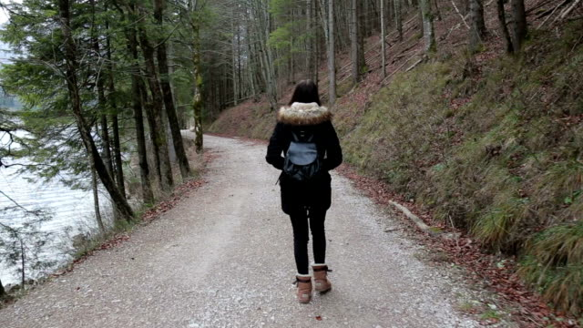 young girl walking near the lake and exploring - wanderlust - upper austria stock videos & royalty-free footage