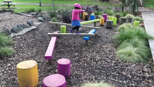 Young girl Walking Through an Obstacle Course