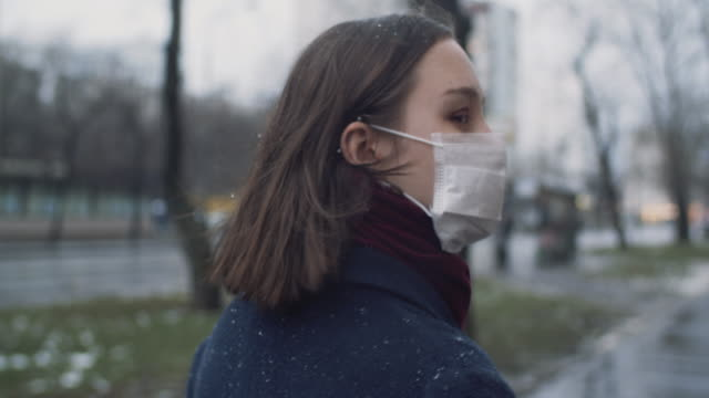 young girl wearing a protective face mask - protective workwear stock videos & royalty-free footage