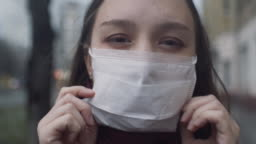 Young girl wearing a protective face mask