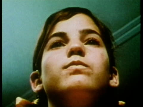 1969 cu la zo young girl wearing hearing aid and repeating words during hearing test/ usa/ audio - deafness stock videos and b-roll footage