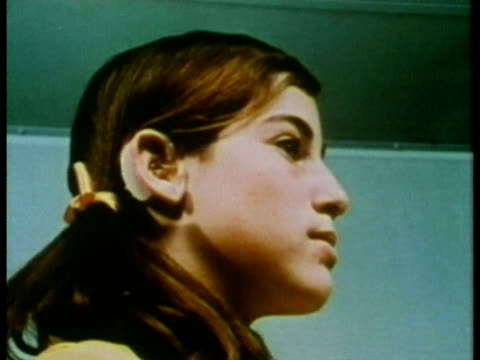 1969 cu la zi young girl wearing hearing aid and repeating words during hearing test/ usa/ audio - deafness stock videos and b-roll footage