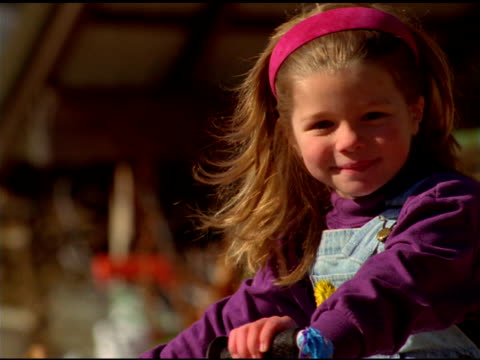 stockvideo's en b-roll-footage met young girl wearing pink head band smiles at camera, vermont - haaraccessoires