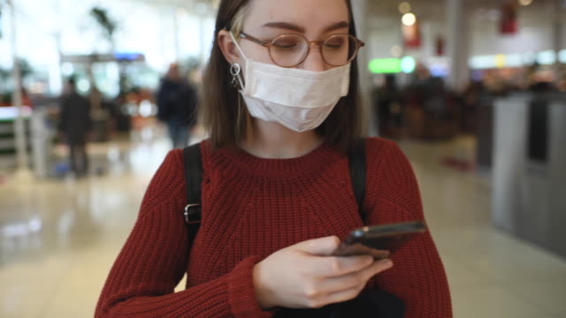 young girl wearing protective medical mask in a shopping mall - surgical mask stock videos & royalty-free footage