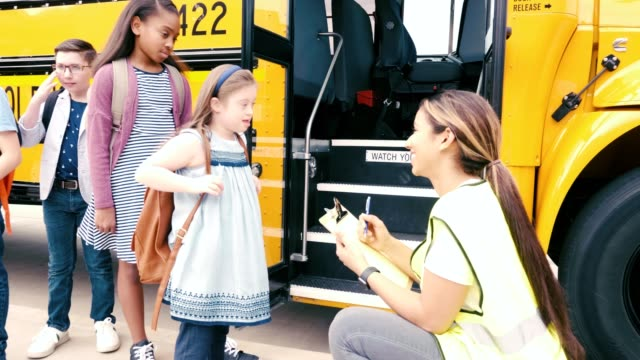 young girl with down syndrome prepares to board school bus - bus driver stock videos & royalty-free footage