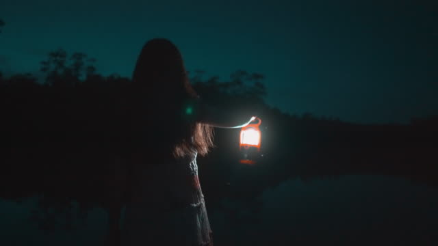 young girl with lantern exploring in nature - lantern stock videos & royalty-free footage