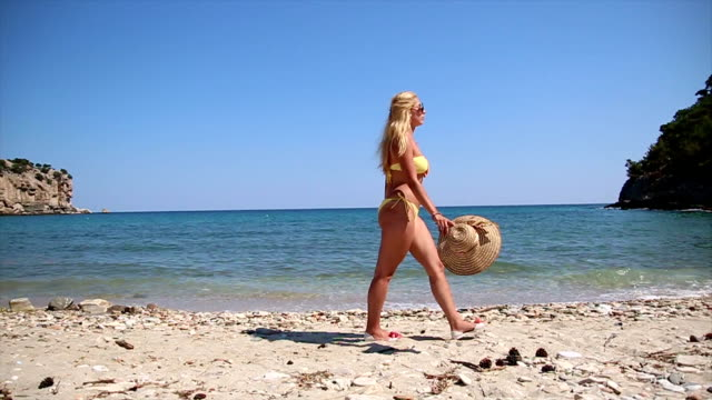 young girl with sun hat walking on beach - sun hat stock videos & royalty-free footage