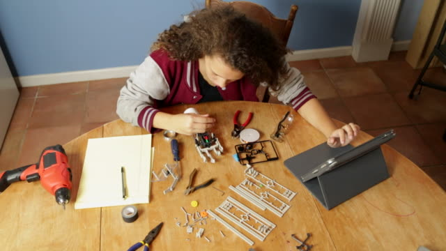 Young Girl Works on Robotics Project