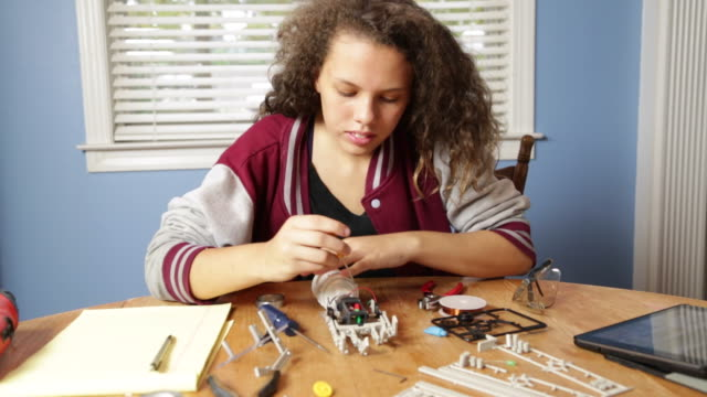 young girl works on robotics project - stem topic stock videos & royalty-free footage