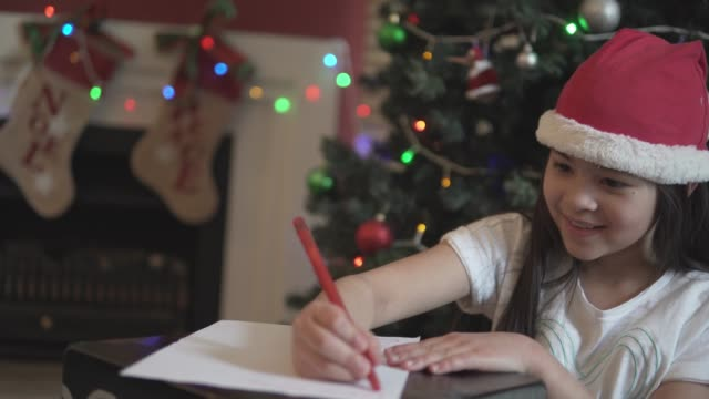 young girl writing a letter to santa - children only video stock e b–roll