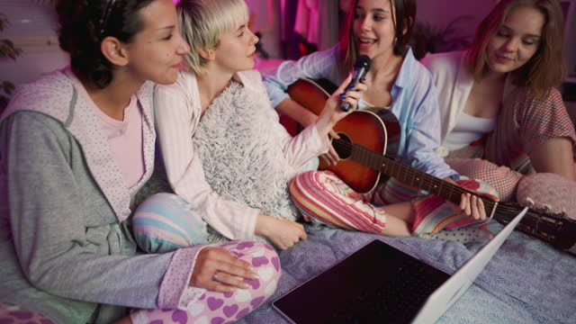 young girlfriends singing karaoke at a slumber party - slumber party stock videos & royalty-free footage