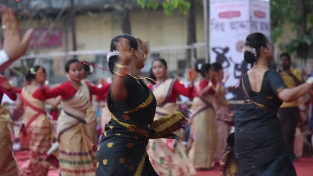 young girls and woman dancing assamese traditional bihu at an event ahead of rongali bihu ot bohag bihu festival on april 12, 2021 in guwahati,... - teenage girls stock videos & royalty-free footage