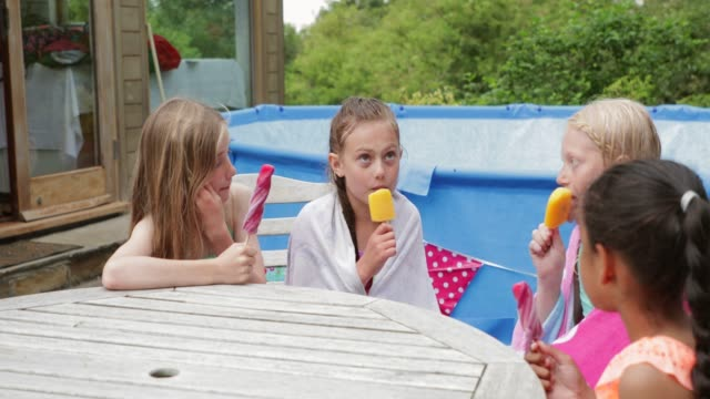 young girls enjoying popsicles - popsicle stick stock videos and b-roll footage