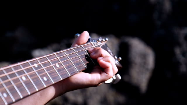 a young girl's hand playing the guitar - musical symbol stock videos & royalty-free footage