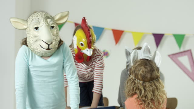 young girls in classroom - wearing funny animal masks - animal representation stock videos & royalty-free footage