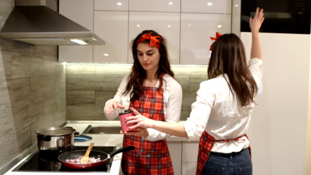 young girls in the kitchen,preparing vegan meal - apron stock videos & royalty-free footage