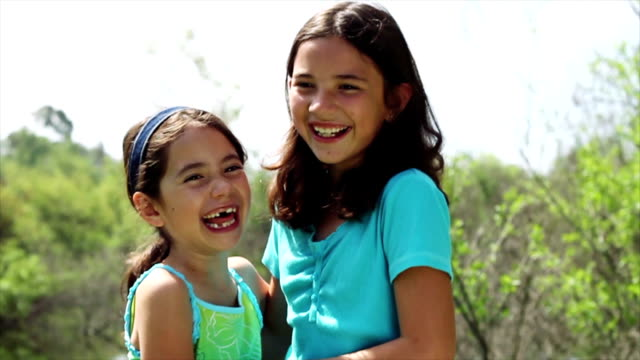 young girls laughing and tickling each other - tickling stock videos & royalty-free footage