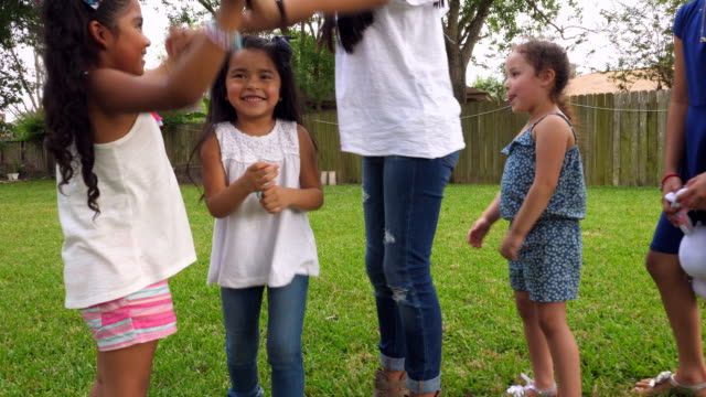 MS Young girls playing games in backyard during family party