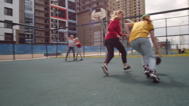 young girls playing streetball on outdoor urban court - 18 19 years stock videos & royalty-free footage
