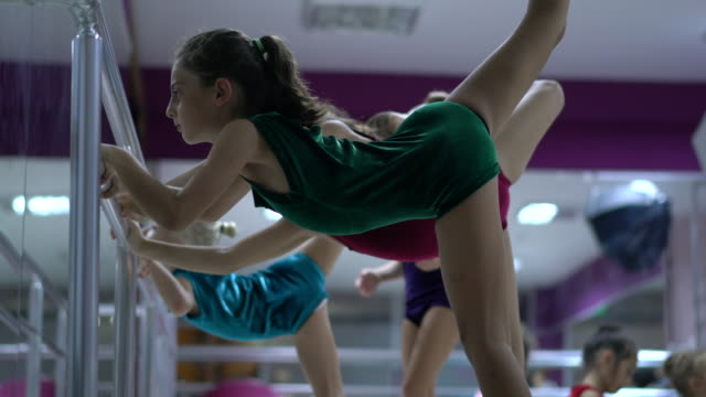 young girls preparing for ballet training indoors - ballet dancing stock videos & royalty-free footage
