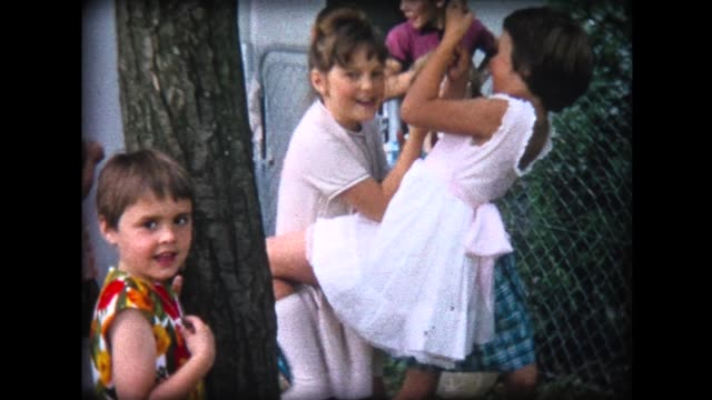 1964 young girls pushing on tree swing - nur kinder stock-videos und b-roll-filmmaterial