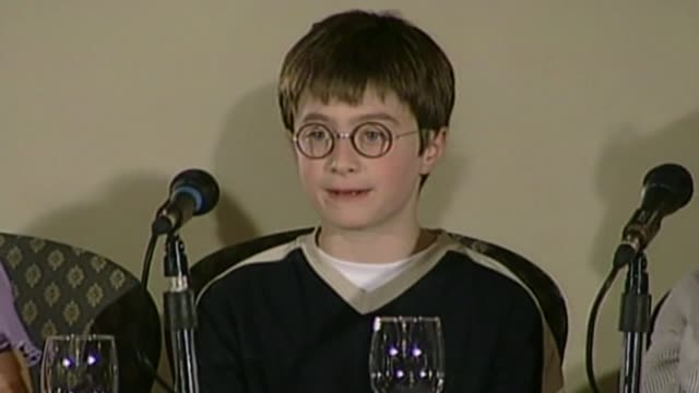 young girls queue to audition for harry potter spin-0ff film; lib london: int daniel radcliffe speaking at press conference after securing the part... - pressekonferenz stock-videos und b-roll-filmmaterial
