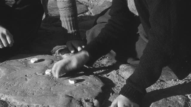 1950 montage young girls sitting on seashore playing jacks and their father joining them in the game / united kingdom - foster care stock videos & royalty-free footage