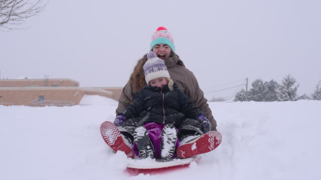 young girls tobogganing - mitten stock videos and b-roll footage