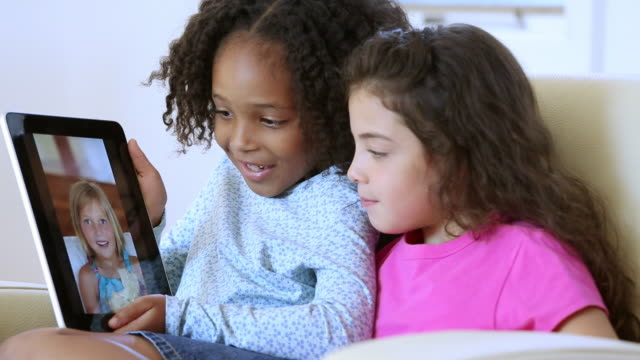 ms young girls video chatting with a friend on tablet computer / richmond, virginia, usa - comment box stock videos & royalty-free footage