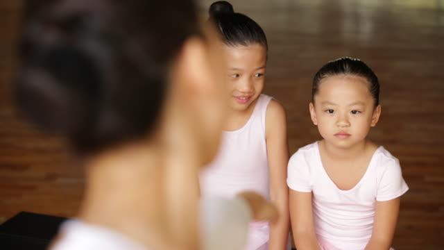 cu young girls watching ballet teacher. - ballettstudio stock-videos und b-roll-filmmaterial