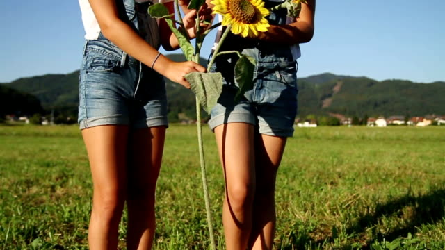 Young girls with sunflowers