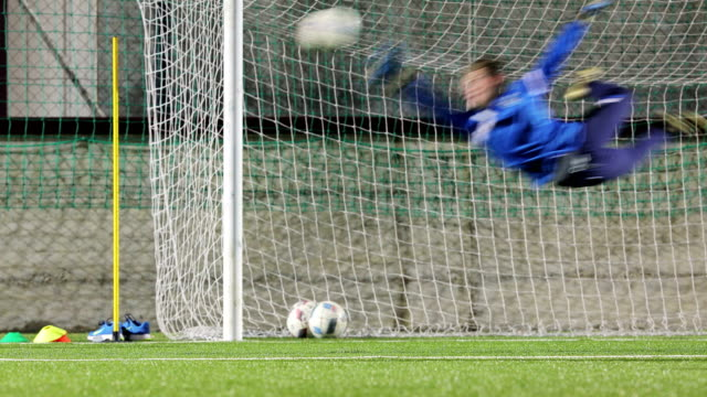 young goalkeeper catching ball on soccer training - catching stock videos & royalty-free footage