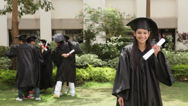 young graduates celebrating  - diploma stock videos & royalty-free footage