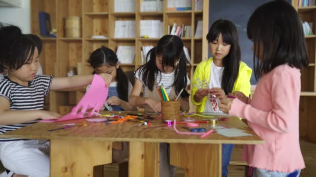 Young group of students enjoying arts and craft activities