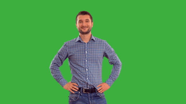 young guy showing copy space on a green background - plaid shirt stock videos & royalty-free footage