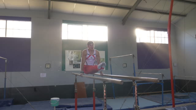 young gymnast training at a gymnastics club - gymnastics stock videos & royalty-free footage