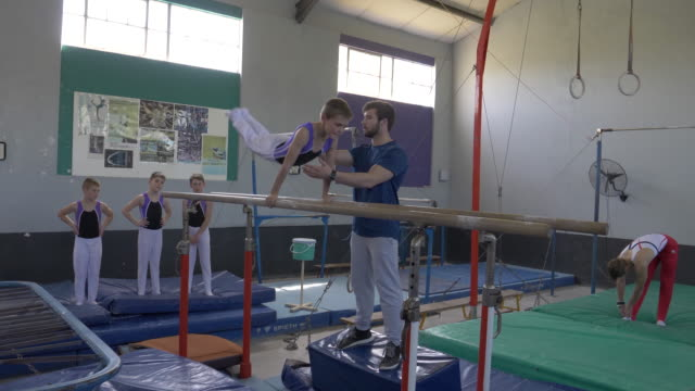 young gymnasts training at a gymnastics club - gymnastics stock videos & royalty-free footage