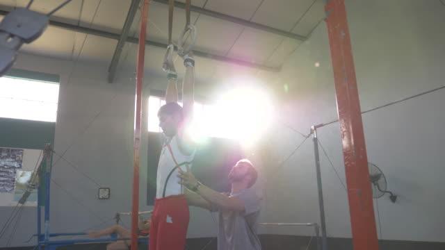 young gymnasts training at a gymnastics club - gymnastic rings stock videos & royalty-free footage