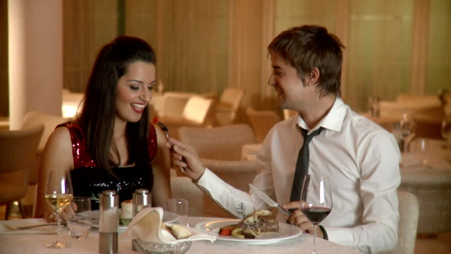 Young happy couple at restaurant